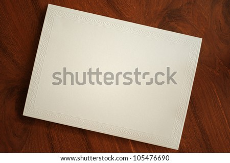 blank card with thai traditional pattern on wooden desk - stock photo
