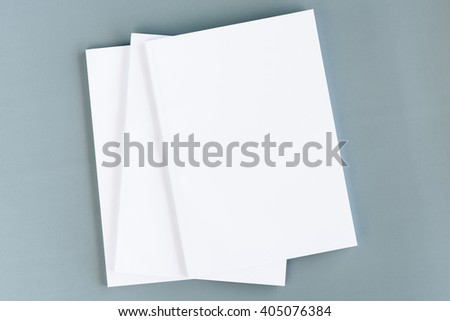 Blank catalog with white cover, magazines, book mock up. Isolated on grey cardboard background, with clipping path already included. Background color / content can be changed or replace as desired. - stock photo