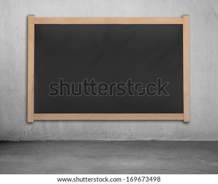 Blank chalk board on concrete wall, office interior - stock photo