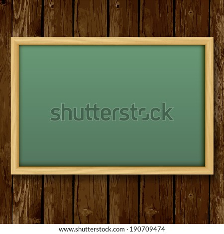 Blank chalk green board in a wood  frame for write and teach on wood background.
