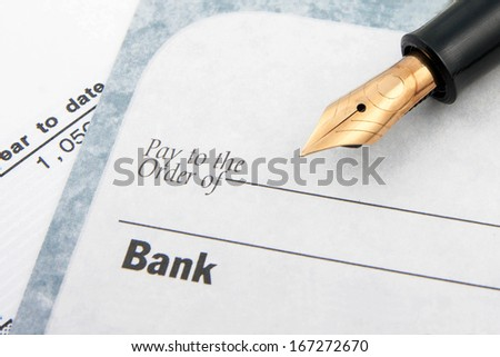 Blank check and fountain pen - stock photo