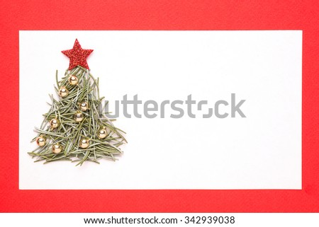 Blank Christmas card or invitation with christmas tree made from pine needles on red background - stock photo
