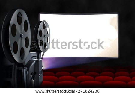 Blank cinema screen with empty seats and projector - stock photo