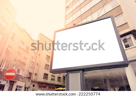 Blank city billboard with buildings in background,selective focus  - stock photo