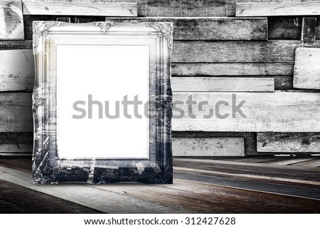 Blank city overlay vintage photo frame leaning at plank wood wall and diagonal wood floor,Mock up for adding your design. - stock photo