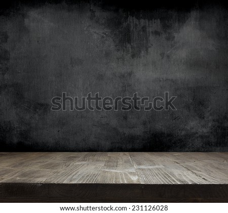 Blank cleaned chalkboard with wooden background - stock photo