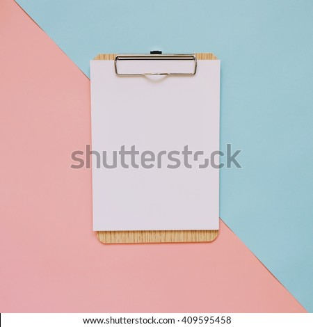 Blank clipboard on pastel color background with copy space, minimal style