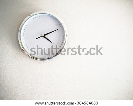 Blank clock on the white wall for background. - stock photo