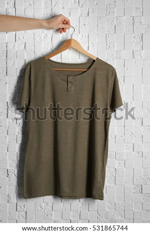 Blank color t-shirt against light textured background
