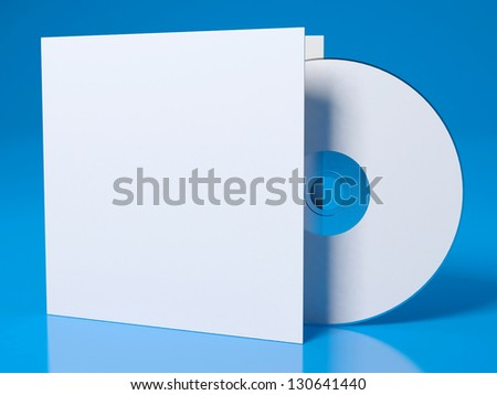 Blank compact disk with cover on blue background - stock photo
