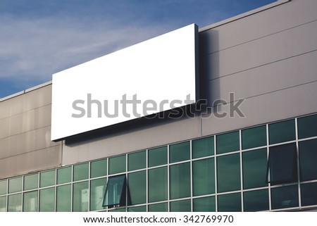 Blank company advertising billboard as copy space, retro toned image - stock photo