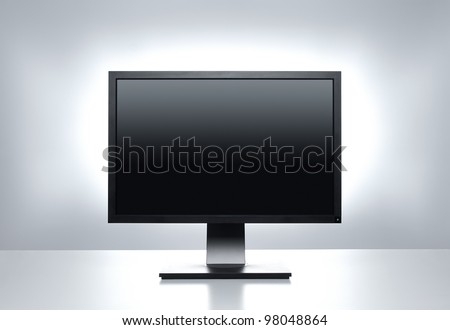 Blank computer monitor at the desk with clipping path - stock photo