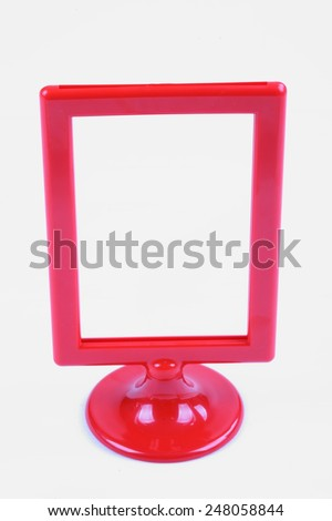 Blank contemporary desktop picture frame isolated on white - stock photo