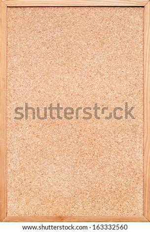 blank cork board / bulletin board with a wooden frame - stock photo