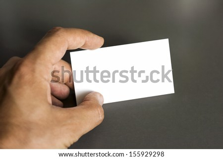 Blank corporate identity package business card in hand. Presentation template for designers.