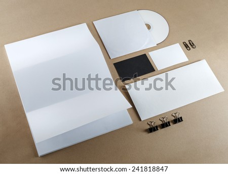 Blank corporate identity set on a table. Top view.