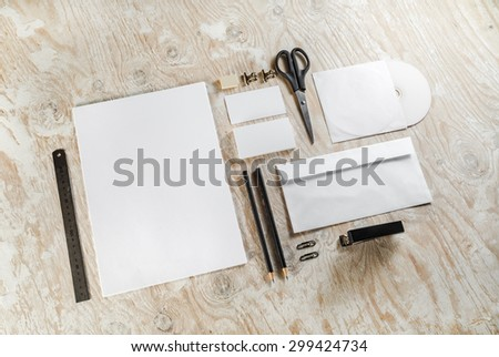 Blank corporate identity template on light wooden background. Mock-up for branding identity. For design presentations and portfolios. - stock photo