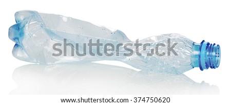 Blank crumpled plastic bottle isolated on white background - stock photo