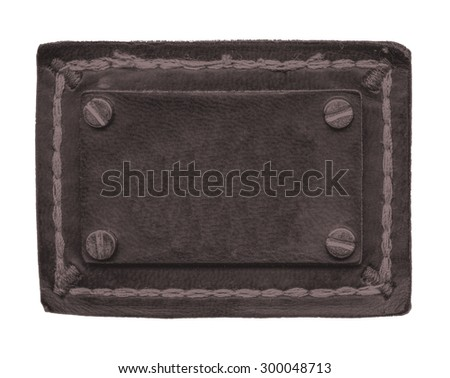 blank dark  brown  jeans leather label decorated with buttons isolated on white