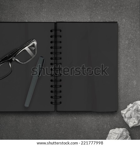 blank dark note book as concept  - stock photo
