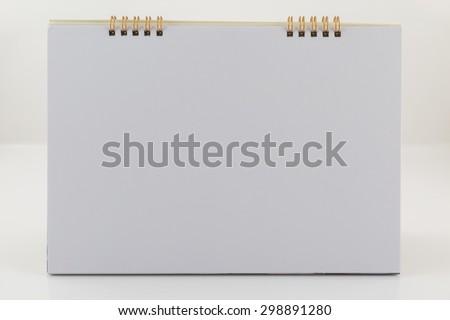 Blank desk calendar on white background - stock photo
