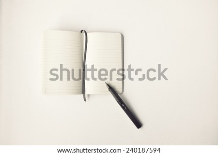 Blank diary and pen on white background - stock photo