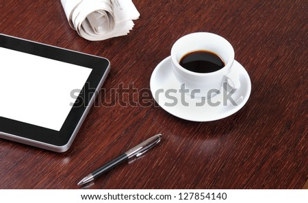 Blank digital tablet on a desk with clipping path for the screen - stock photo