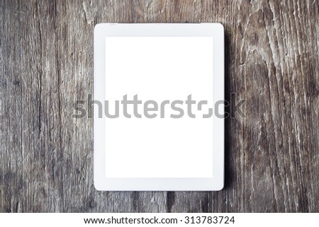 Blank digital tablet on a wooden table, mock up - stock photo
