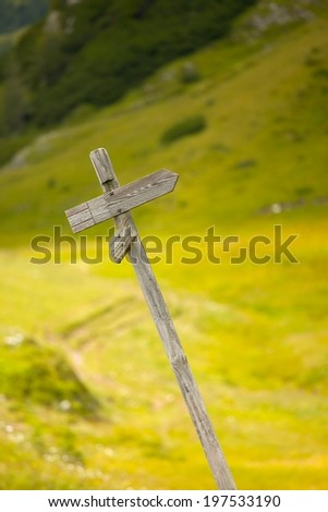 Blank direction sign in the mountains - stock photo