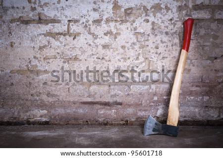 Blank dirty grunge wall with axe