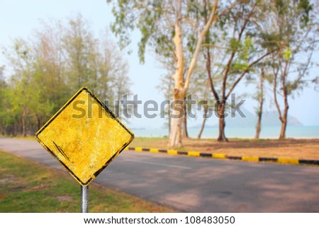 Blank dirty yellow road sign