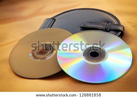 Blank DVD disks and black disk bag. - stock photo