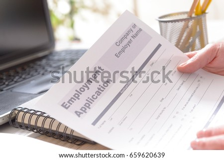 blank employment application form hands on stock photo 659620639