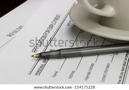 Blank employment application with resume, pen and coffee on desk. - stock photo