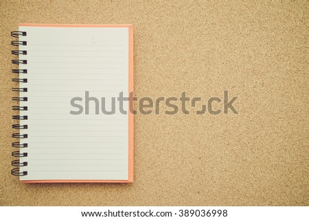 Blank empty notepad on cork board - stock photo