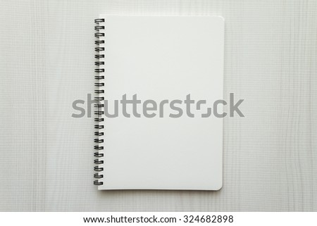 Blank empty notepad on white wood table - stock photo