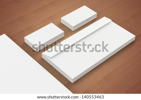Blank Envelopes , a4 paper stack  and  Business card on wooden background with soft shadows