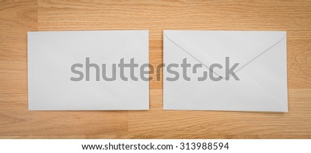 Blank envelopes on a wooden dark background - stock photo