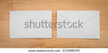 Blank envelopes on a wooden dark background - stock photo