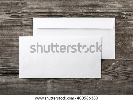 Blank envelopes on wooden background. Back and front view. Template for ID. Top view. For design presentations and portfolios. - stock photo