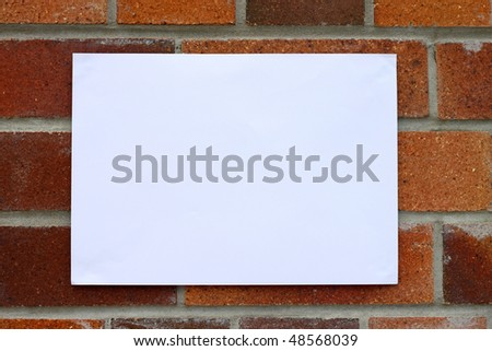 Blank flyer awaiting message for housing related information. - stock photo