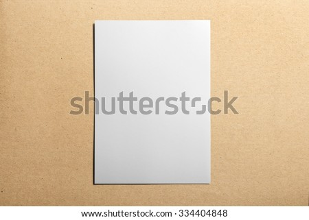 Blank flyer, leaflet isolated on cardboard background, with clipping path, changeable background - stock photo