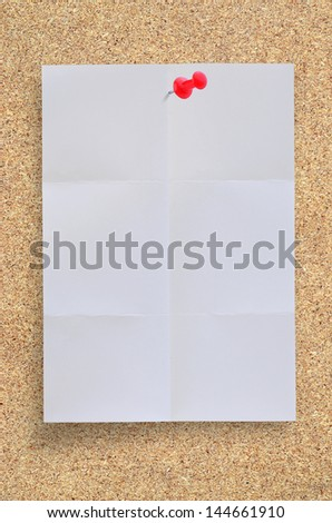 Blank fold paper with pushpin on board for your text or copy space