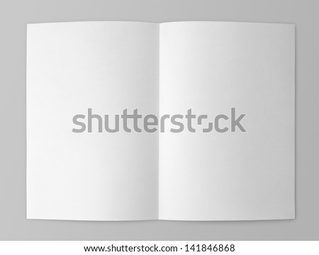 Blank folded flyer isolated on gray with clipping path - stock photo