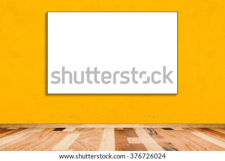 Blank folded paper poster hanging on yellow wall, you can put your message.