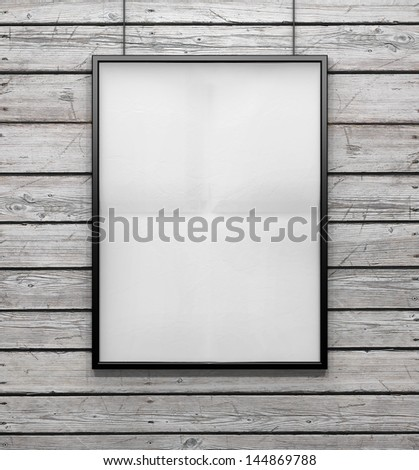 blank frame on a vintage wood wall - stock photo