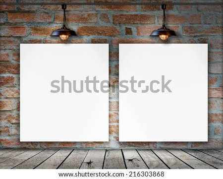 Blank frame on brick wall and wood floor for information message - stock photo