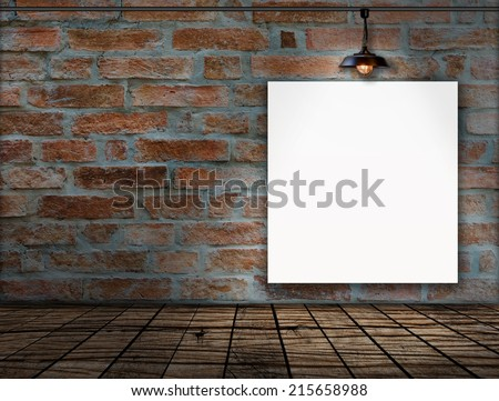 Blank frame on Brick wall with Ceiling lamp - stock photo