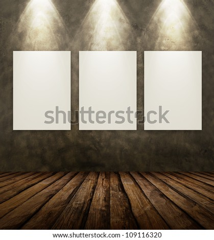 Blank frame on stone wall illuminated spotlights in interior room.