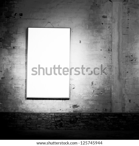 blank frame on vintage old wall black and white - stock photo